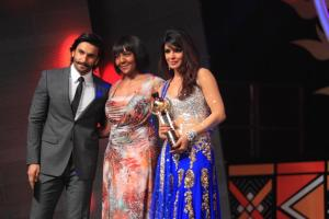 Priyanka Chopra receiving Lead Actor Female Film India by Ranveer Singh, Ndeleka Mandela at SAIFTA in Durban, South Africa, September 6, 2013.